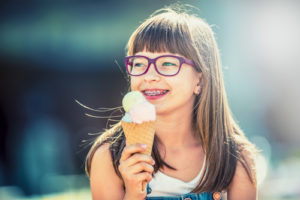 Young Girl with Braces & ice cream cone