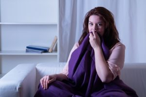 woman waking up worried