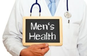 doctor holding Men's Health sign