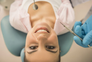 woman in dental chair upside down view