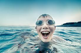 boy with braces swimming